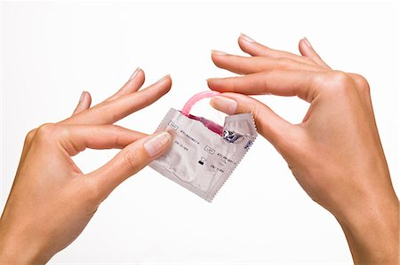 Woman's hands holding a condom Stock Photo - Rights-Managed, Code: 877-06832579