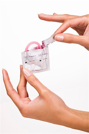 Woman's hands holding a condom Stock Photo - Rights-Managed, Code: 877-06832580