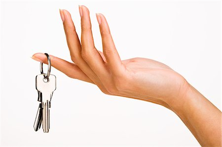 finger holding a key - Woman's hand holding keys Stock Photo - Rights-Managed, Code: 877-06832607