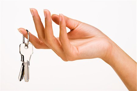 finger holding a key - Woman's hand holding keys Stock Photo - Rights-Managed, Code: 877-06832608