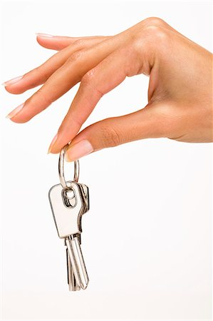 finger holding a key - Woman's hand holding keys Stock Photo - Rights-Managed, Code: 877-06832603