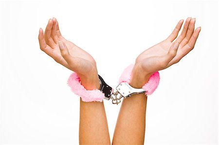 people having sex - Woman's hands wearing fur handcuffs, close-up Stock Photo - Rights-Managed, Code: 877-06832682