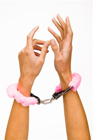 Woman's hands wearing fur handcuffs, close-up Stock Photo - Rights-Managed, Code: 877-06832683