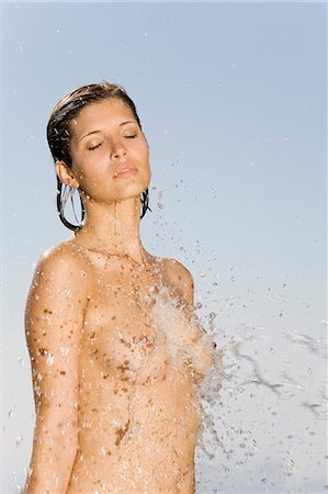 Naked young woman under shower Stock Photo - Rights-Managed, Code: 877-06832991