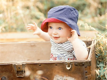 Baby boy sitting in a suitcase Stock Photo - Rights-Managed, Code: 877-06833268