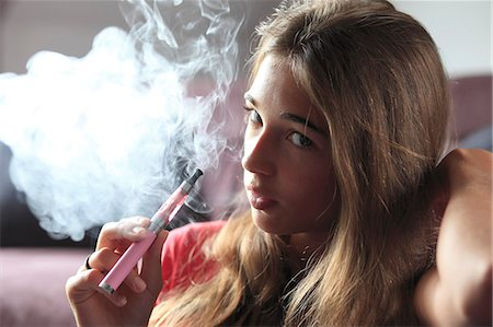 France, young girl smoking an electronic cigarette Stock Photo - Rights-Managed, Code: 877-07460424