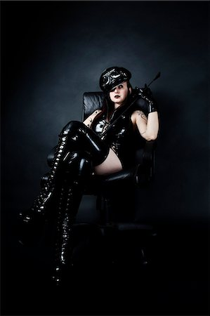 riding crop - Domina sitting with a riding crop Stock Photo - Rights-Managed, Code: 877-07460525