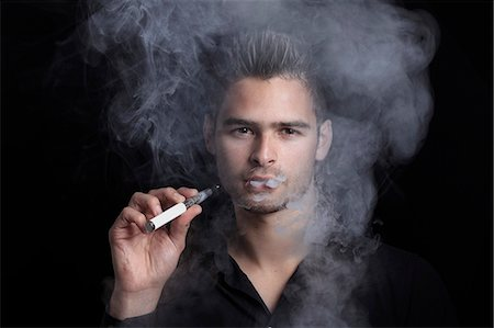 smoke - France, young man smoking an electronic cigarette. Stock Photo - Rights-Managed, Code: 877-07460576