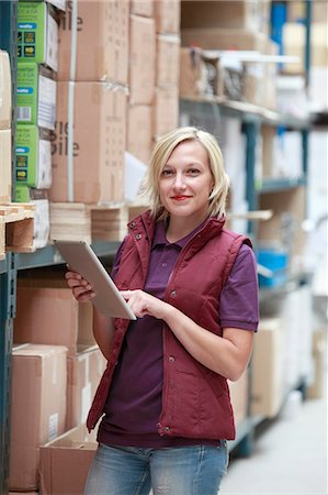 ebusiness - France, young woman using tablet computer in warehouse. Stock Photo - Rights-Managed, Code: 877-07460584