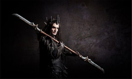Dark Elf with a spear over shoulder Stock Photo - Rights-Managed, Code: 877-07460631