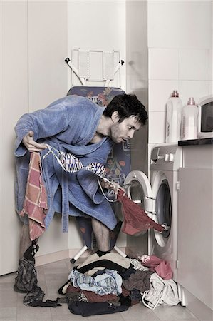 a man empties the washing machine Stock Photo - Rights-Managed, Code: 877-08026441