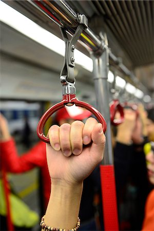People holding on to a handle on a train in Hong Kong subway,China Stock Photo - Rights-Managed, Code: 877-08026551