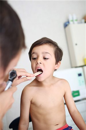 Young patient undergoing oral examination Stock Photo - Rights-Managed, Code: 877-08031336