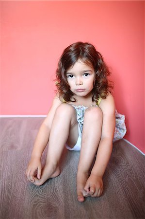 Portrait of a 4 years old girl pouting Stock Photo - Rights-Managed, Code: 877-08031349