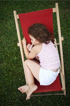 Portait of a 4 years old girl on a lounge chair for child Stock Photo - Rights-Managed, Code: 877-08031358