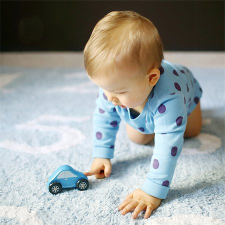 A 15 months baby boy playing with a car Stock Photo - Rights-Managed, Code: 877-08079115