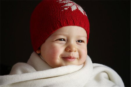 A 15 months baby boy with a cap and a scarf Stock Photo - Rights-Managed, Code: 877-08079119
