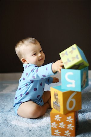 A 15 months baby boy playing with cubes Stock Photo - Rights-Managed, Code: 877-08079111