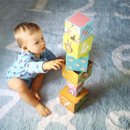 A 15 months baby boy playing with cubes Stock Photo - Rights-Managed, Code: 877-08079113