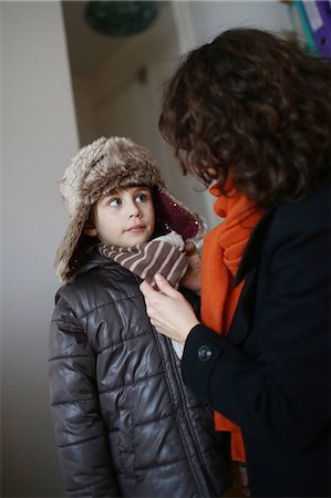 A mom dressing her 5 years old boy before to go outside Stock Photo - Rights-Managed, Code: 877-08079179