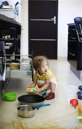 A 2 years old little girl playing in a kitchen in which she made the mess Stock Photo - Rights-Managed, Code: 877-08079197