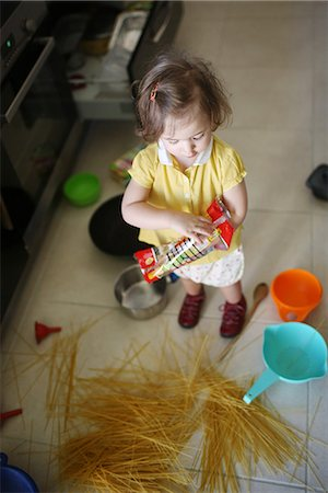 A 2 years old little girl making the mess in a kitchen Stock Photo - Rights-Managed, Code: 877-08079191