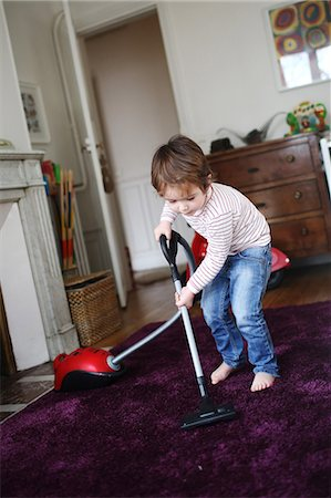 Little boy using vacuum cleaner Stock Photo - Rights-Managed, Code: 877-08079247