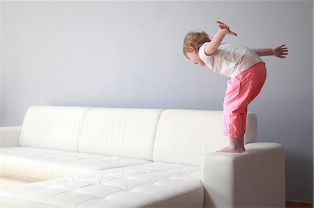 dangerous accident - France,  4 years old girl on sofa arm. Stock Photo - Rights-Managed, Code: 877-08127997