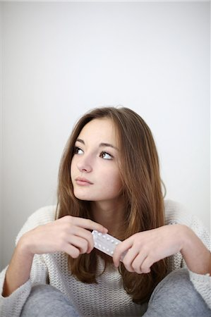 people having sex - A teenage girl posing with a plate of contraceptive pills Stock Photo - Rights-Managed, Code: 877-08128057