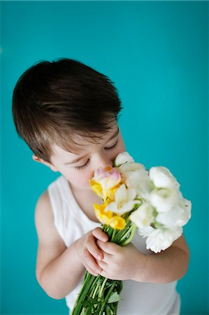 Little boy with flowers Stock Photo - Rights-Managed, Code: 877-08128085