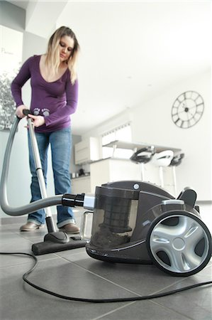 France, pregnant woman at home passing vacuum cleaner. Stock Photo - Rights-Managed, Code: 877-08128677