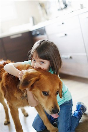 dog kissing girl - Girl playing with a dog Stock Photo - Rights-Managed, Code: 877-08128842
