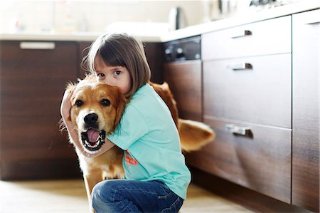 dog kissing girl - Girl playing with a dog Stock Photo - Rights-Managed, Code: 877-08128843