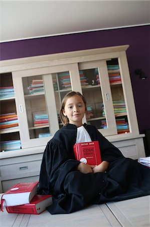 right - Little girl wearing a black robe as a judge Stock Photo - Rights-Managed, Code: 877-08128935