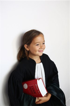 right - Little girl wearing a black robe as a judge Stock Photo - Rights-Managed, Code: 877-08128936