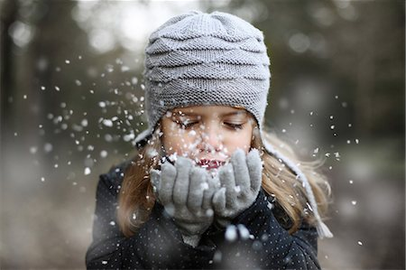 Girl holding snow in her hands Stock Photo - Rights-Managed, Code: 877-08128948