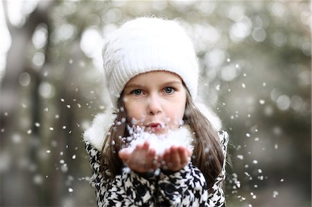 Girl holding snow in her hands Stock Photo - Rights-Managed, Code: 877-08128949