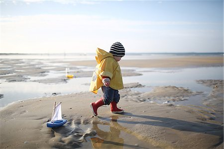 A 1 year old boy plays on the beach Stock Photo - Rights-Managed, Code: 877-08129105
