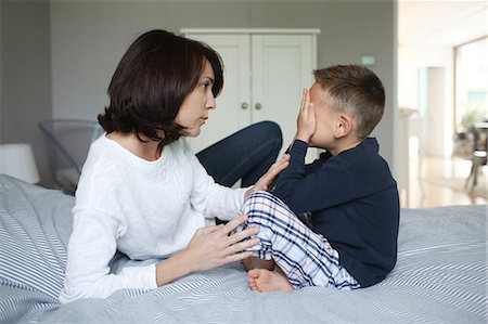 A mom consoling her 5 years old son Stock Photo - Rights-Managed, Code: 877-08129220