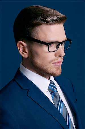 man in blue suit, tie, beard; blue background, glasses Stock Photo - Rights-Managed, Code: 877-08129447