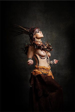 Tribal woman dancing in traditional costume Stock Photo - Rights-Managed, Code: 877-08129468