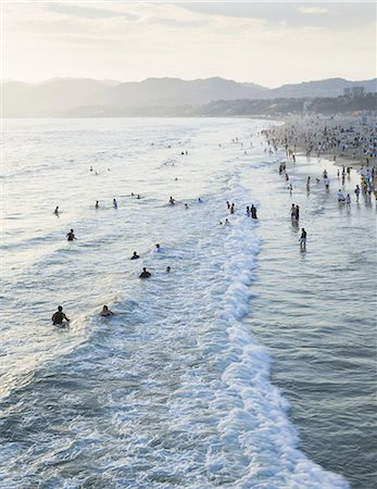 southern california - Large group of people swimming in the ocean at Santa Monica, California. Stock Photo - Rights-Managed, Code: 878-07442490