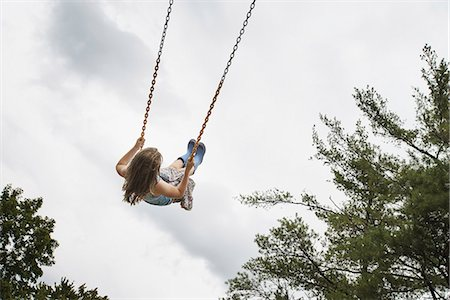 swing (sports) - A girl on a rope swing, high in the air Stock Photo - Rights-Managed, Code: 878-07442517
