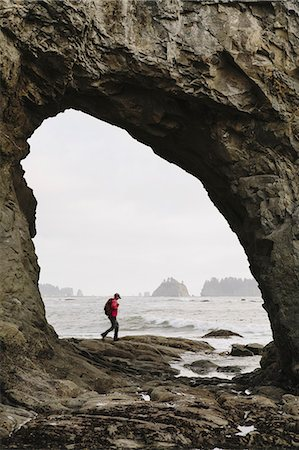 Man hiking on the beach at Hole-in-the-Rock on Rialto Beach Stock Photo - Rights-Managed, Code: 878-07442527