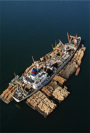Rainforest lumber loaded on freighter, an aerial view of the timber on rafts and on board, in Sandakan, Borneo Stock Photo - Rights-Managed, Code: 878-07442620