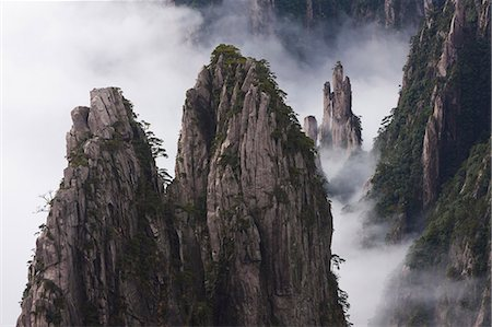 Huang Shan, which means Yellow Mountain. Anhui Provice in China. Jagged rock towers. Stock Photo - Rights-Managed, Code: 878-07442700