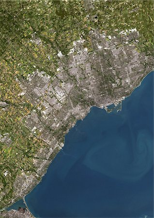 Toronto, Canada, True Colour Satellite Image. Toronto, Canada. True colour satellite image of the city of Toronto. Composite of 2 images taken on 3 September 1999 & 10 August 2002 using LANDSAT 7 data. Stock Photo - Rights-Managed, Code: 872-06052949