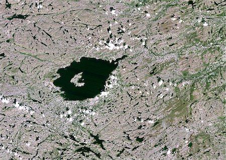 Mistastin Meteor Impact Crater, Labrador, Canada, True Colour Satellite Image. True colour satellite image of Mistastin impact structure, Labrador, Canada (diameter : 28 km). Image taken on 1 August 1987 using LANDSAT data. Stock Photo - Rights-Managed, Code: 872-06053128