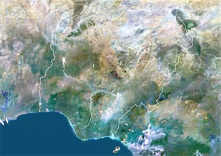 Nigeria, Africa, True Colour Satellite Image With Border. Satellite view of Nigeria (with border). This image was compiled from data acquired by LANDSAT 5 & 7 satellites. Stock Photo - Rights-Managed, Code: 872-06053372