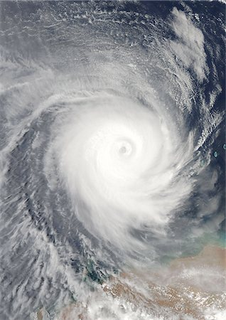 spiral - Cyclone Billy, Australia, In 2008, True Colour Satellite Image. Tropical Cyclone Billy over the Indian Ocean, off the coast of Western Australia, on 25 December 2008. True-colour satellite image using MODIS data. Stock Photo - Rights-Managed, Code: 872-06053820